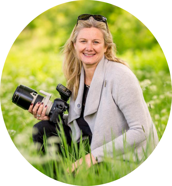 female holding camera outside