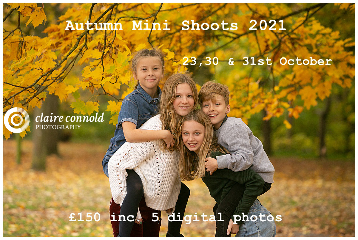 4 kids grouped autumn trees in the background